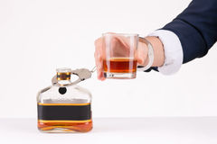Male hand chained to bottle of liquor Stock Photo