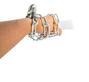 Male Hand, Chains and Cigarette II. Concept image of cigarette addiction enslavement Stock Photos