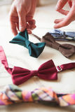 The male hand choosing hand made bow ties Royalty Free Stock Photo