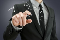 Male hand choosing plan B on a virtual screen Stock Photos