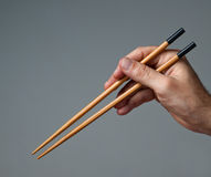 Male hand with  chopsticks. Stock Photography