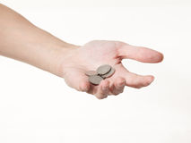 A male hand with coins. On a white background Royalty Free Stock Images