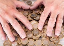 Male Hand On Coins Stock Photography