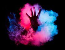 Male hand from colorful smoke Stock Photography