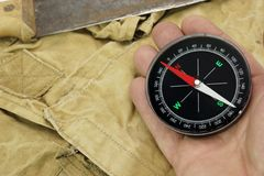 Male Hand With Compass And Machete On The Backpack Royalty Free Stock Photography