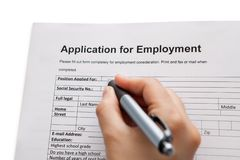 Male hand completing a job application Stock Photography