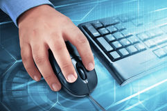 Male hand on computer mouse with keyboard beside him Royalty Free Stock Image