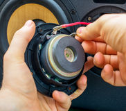 Male hand connecting speaker. Royalty Free Stock Images