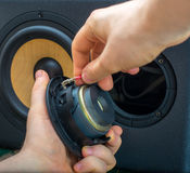Male hand connecting speaker. Stock Photography