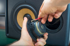 Male hand connecting speaker. Royalty Free Stock Photo