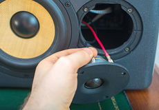 Male hand connecting speaker. Stock Photo