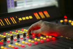 Male hand on control Film Mixing console. Male hand on control Fader on Film Mixing console Royalty Free Stock Image