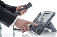Male hand dialing number Stock Photography