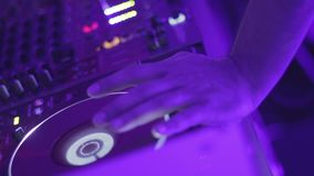 Male hand on dj turntable, disk jockey mixing music records, nightclub party. Stock footage stock video