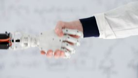 Male hand of doctor prosthetist shakes hand robotic prosthesis in medical center