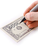 Male hand draw nil on dollar Stock Images