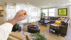 Male Hand Drawing Entertainment Center Over Photo of Home Interi. Male Hand Drawing Entertainment Center Unit Over Photo of Beautiful Home Interior Stock Photo