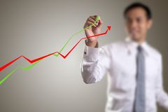 Male hand drawing a graph royalty free stock image