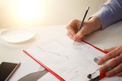 The male hand drawing a graph of growth Stock Photography