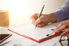 The male hand drawing a graph of growth Stock Image