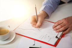 The male hand drawing a graph of growth Royalty Free Stock Image