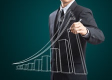Male hand drawing a growth graph. Business man drawing a growth graph Stock Photos
