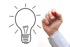 Male hand drawing light bulb over a White Background Royalty Free Stock Photography