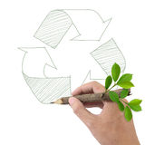 Male hand drawing recycle symbol. Stock Photo