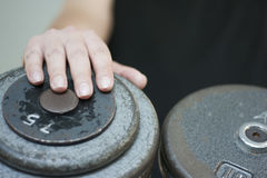 Male hand on dumbbell weight. Detail Royalty Free Stock Photography