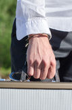 Male hand enchained to suitcase Royalty Free Stock Photos