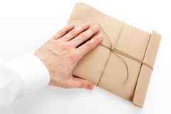 Male hand and envelope tied with a rope Stock Photos