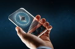 Male hand with ethereum on smartphone screen. Business, cryptocurrency and future technology concept - close up of businessman hand with transparent smartphone Stock Image