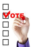 Male hand fill a voting form Stock Image