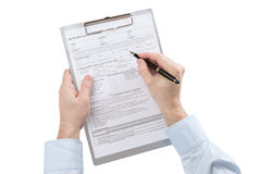 Male hand fills the vehicle leasing contract Royalty Free Stock Images