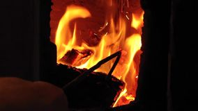 Male hand with fire poker turns burning firewood in old rustic brick stove with door open & Burning Firewood In Old Rustic Brick Stove With Open Door. Stock ...