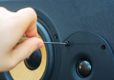 Male hand fixing tweeter. Male hand fixing professional studio monitor Stock Photo