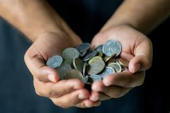 Male Hand Full Of Coins stock images