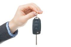Male hand giving car keys - studio shot isolated on white background Royalty Free Stock Image