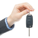 Male hand giving car keys - studio shot Royalty Free Stock Images