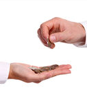Male hand giving a euro coin to another person Stock Photos
