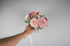 Male hand giving wedding bouquet Royalty Free Stock Photos