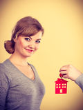 Male hand giving woman house key Stock Photo
