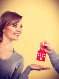 Male hand giving woman house key Stock Photos