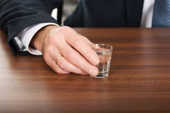 Male hand with a glass of alcohol Stock Photo