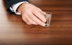 Male hand with a glass of alcohol Stock Image