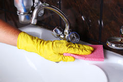 Male hand in gloves with sponge cleaning bathroom Stock Photography