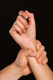 Male hand grabbing female wrist Royalty Free Stock Image