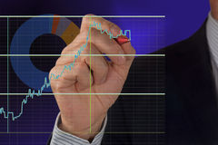 Male hand and graph. Male hand drawing a graph royalty free stock images
