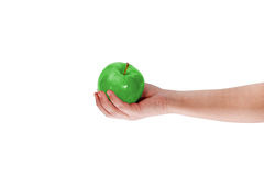Male hand with green apple Stock Photos