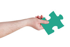 Male hand with green puzzle piece Royalty Free Stock Image